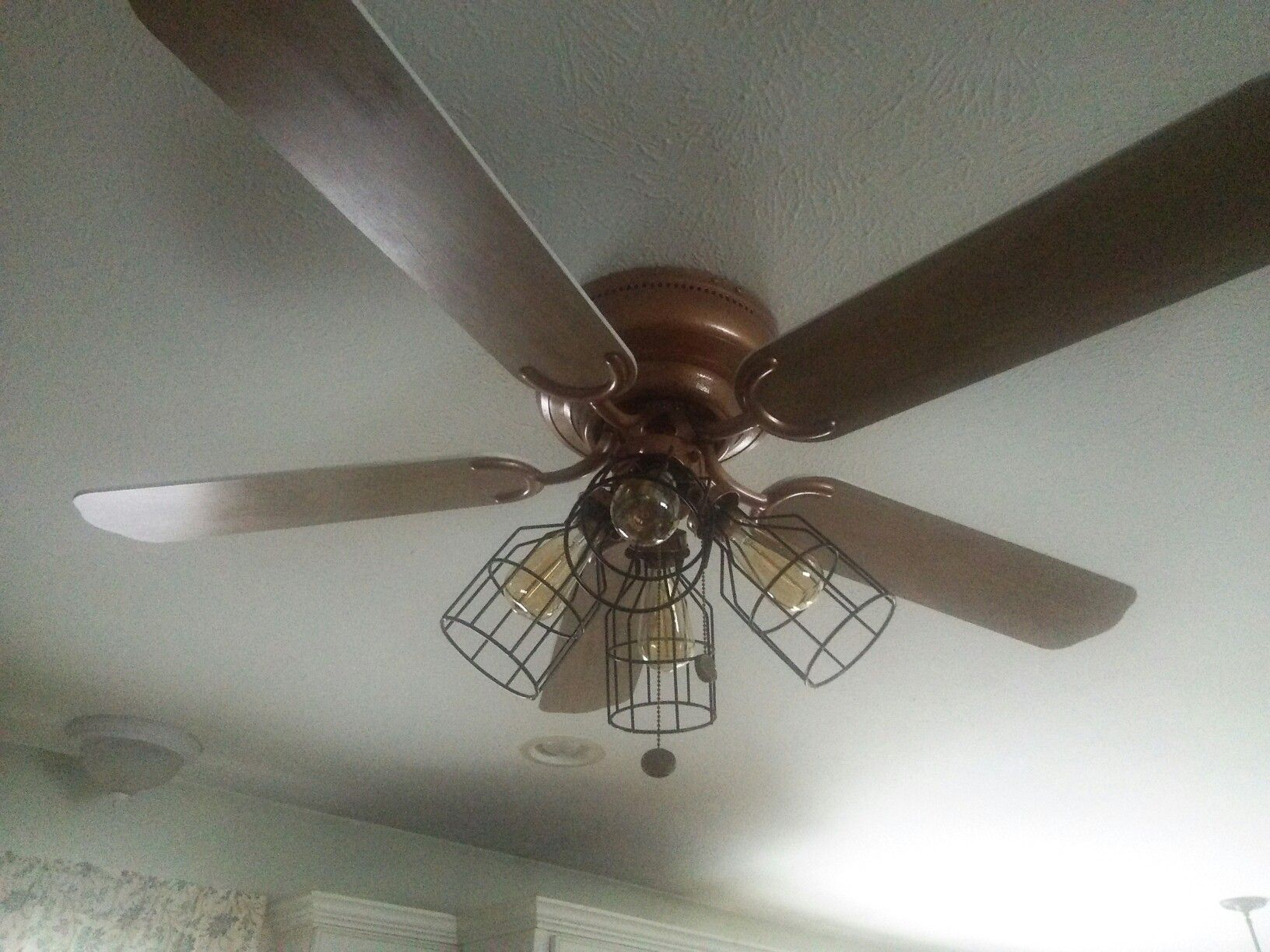 Refurbished ceiling fan from white and gold to hammered bronze with refurbished ceiling fan from white and gold to hammered bronze with wire cage globe covers and edison bulbs by diana lydy heath mozeypictures Image collections