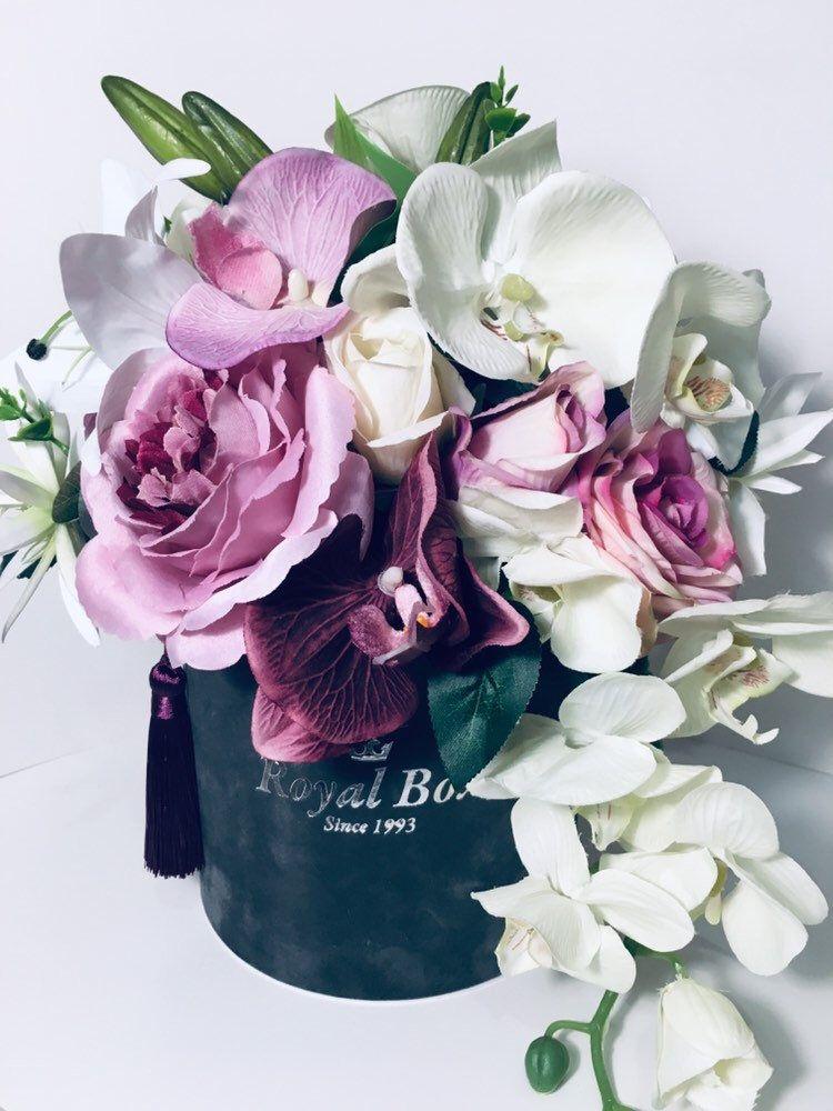 Artificial flower arrangement in a box purple roses