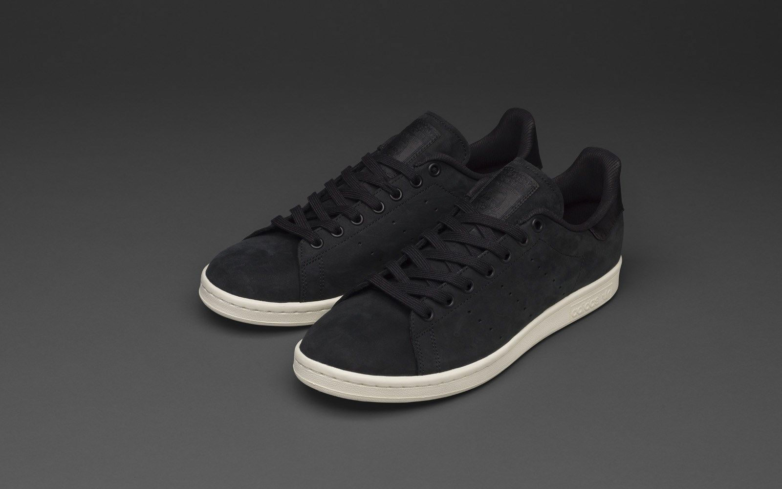 "62df4208119a The adidas Stan Smith ""Tuxedo"" has an upper in soft premium nubuck. On the  back of the shoe you ll find a non branded satin heel tab that gives the sh"