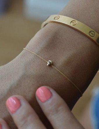 still obsessed. tiny skull bracelet.