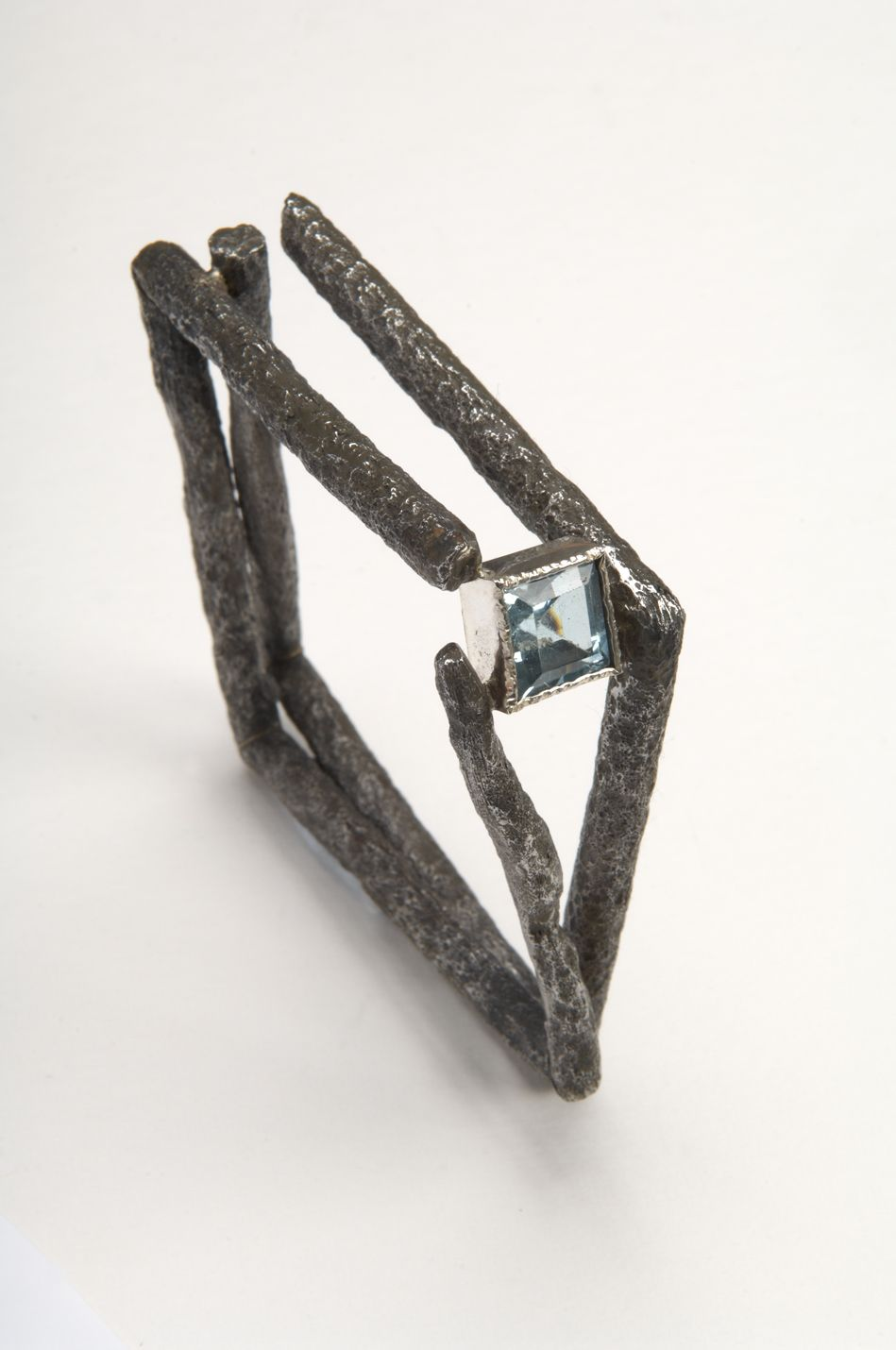 Willem Heyneker's Blog: Bracelet is constructed from found steel(rusty tent pegs)and a synthetic blue topaz.