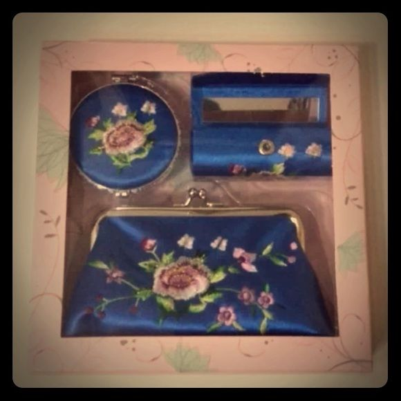 3 Piece Floral Purse Set 3 piece set with coin purse, lipstick case and a  compact mirror. Blue with beautiful flowers.  Brand new in box. Bags Cosmetic Bags & Cases
