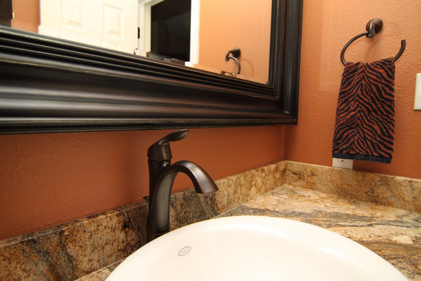 Charming oil-rubbed bronze fixtures in hall bathroom ...