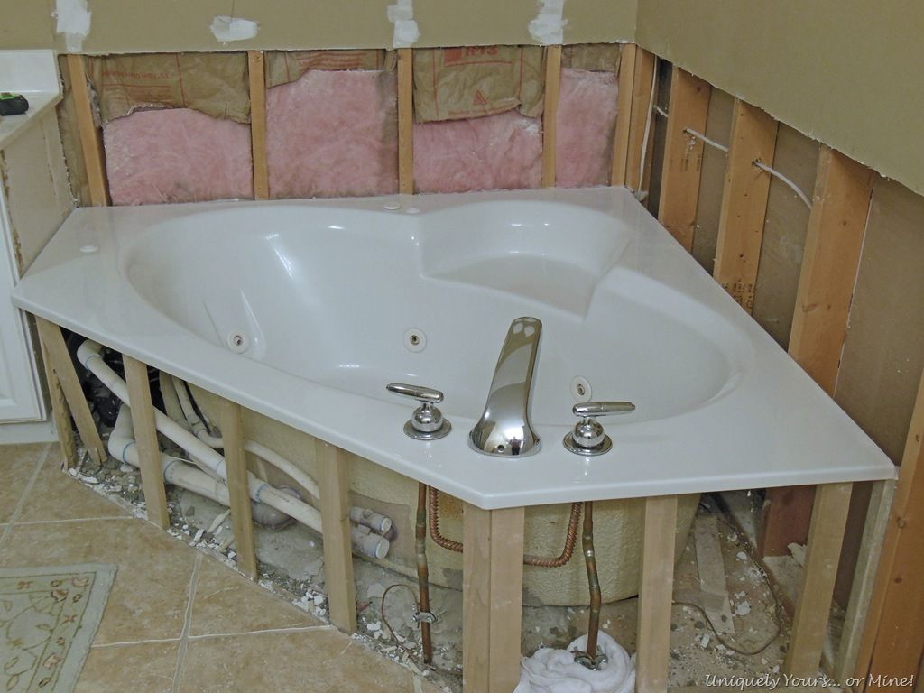Removing wall tile from tub surround in bathroom | Breck remodel ...