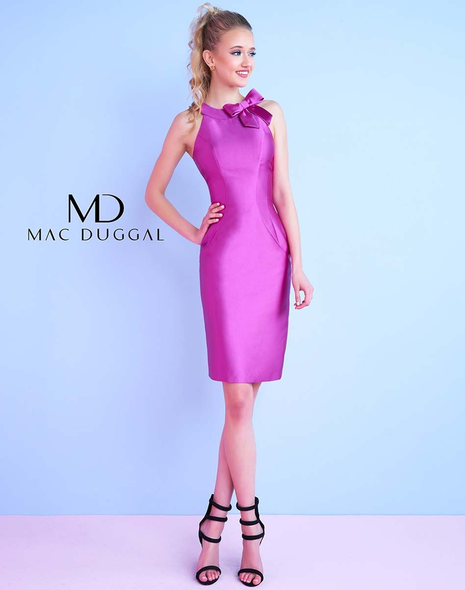 Satin sheath dress with grecian neckline, princess seams and bow detail. This Homecoming dress comes in Magenta.