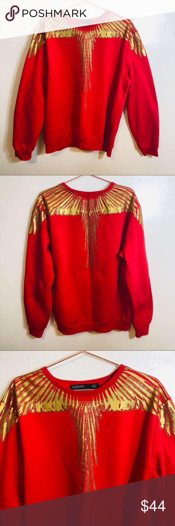 """Hudson Outerwear Red Gold Foil long Sweatshirt Men Hudson Red Gold Bling long Sleeve Sweater  Great Condition  Fabric: See Pictures for Details  Below are flat lay approximate measurements in inches:  Armpit 26"""" Sleeve 27"""" Length 28""""  No swaps/Trades 🛑 Offers Welcome.  Please browse rest of my closet LIKE,SHARE, MAKE OFFERS, BUY!!  I share other Posh Closets Daily  💯 👍🏼❤️  Please check out the rest of my closet.     Thanks for Poshing 😁 thru🥂  Item- Sweater Hudson Outerwear Sweaters"""