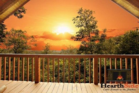 """Gorgeous studio-style log cabin with an awesome mountain setting, hot tub, jacuzzi and more views, views, views! Exceptional quality furnishings and perfect HONEYMOON setting. This is the perfect log cabin retreat for your honeymoon, special anniversary or romantic getaway. Can't you just picture you and your """"sweetie"""" sitting and swinging on this awesome deck with a cold drink or hot coffee? #Pigeon #Forge #honeymoon #anniversary #getaway #romantic #couples #cabin"""