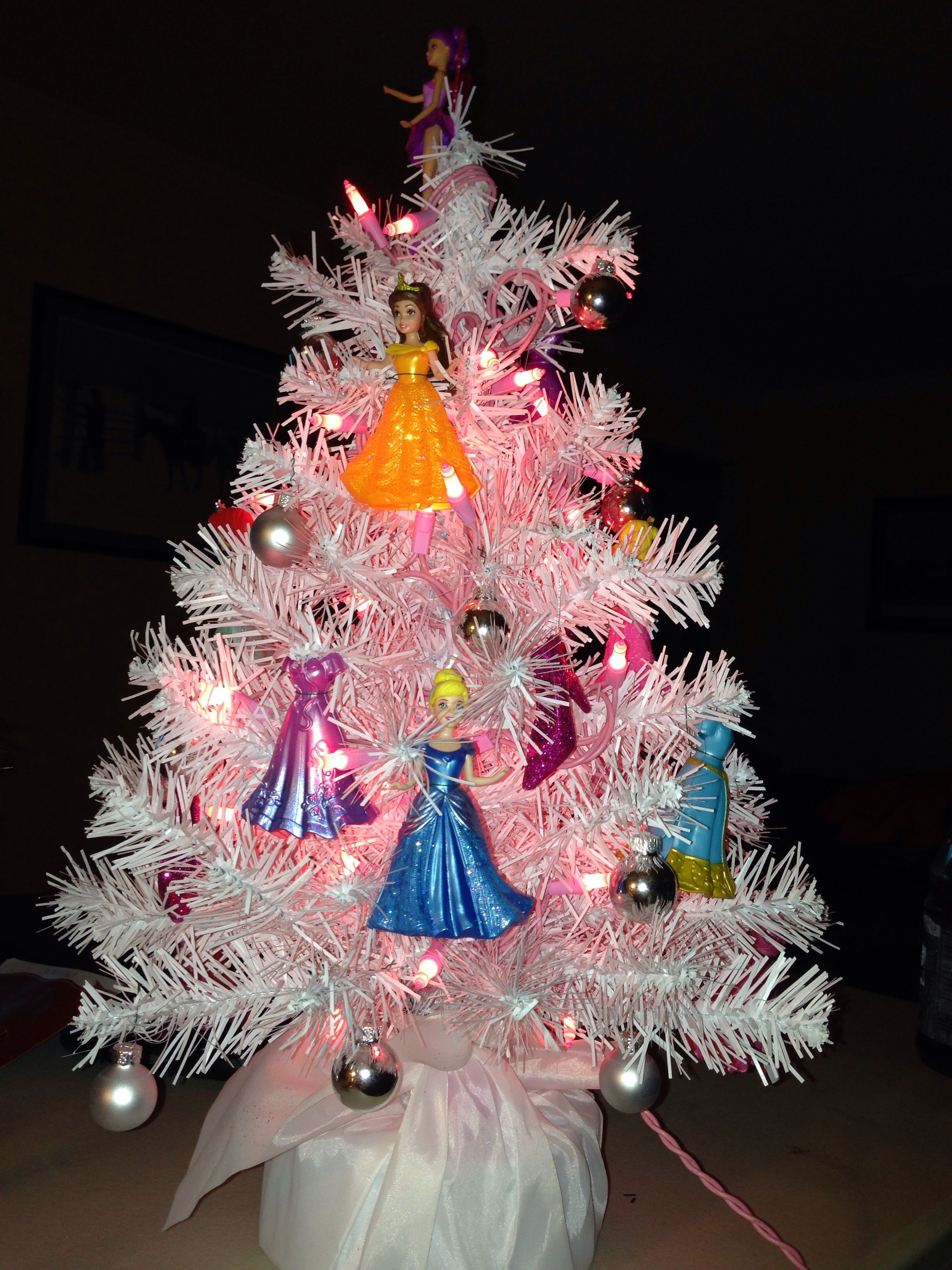This is my granddaughters Princess Christmas Tree. She loves the Disney  Princesses. Clear lights were on it originally, but I replaced them with  pink light ...