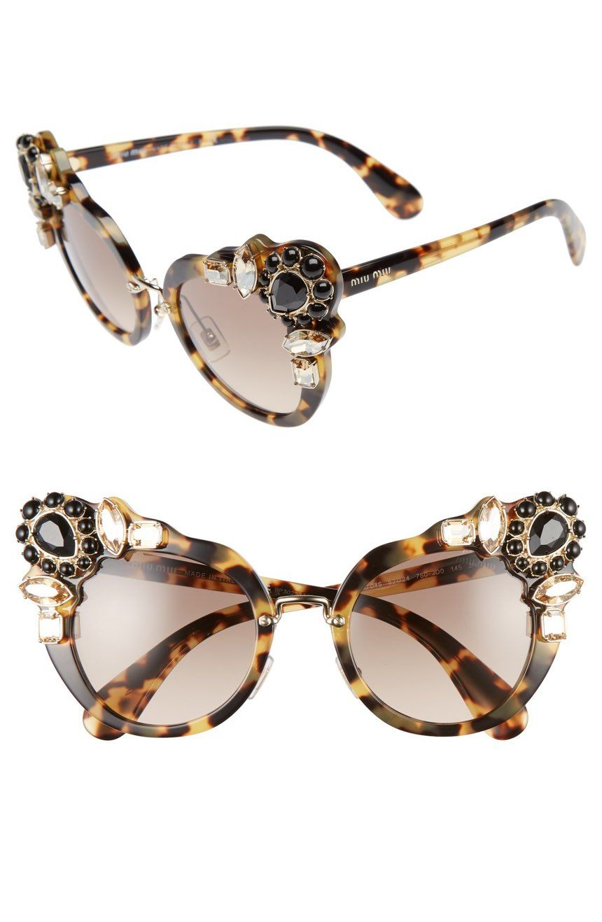 Sparkling crystals add a Deco-inspired twist to the bold cat-eye ...