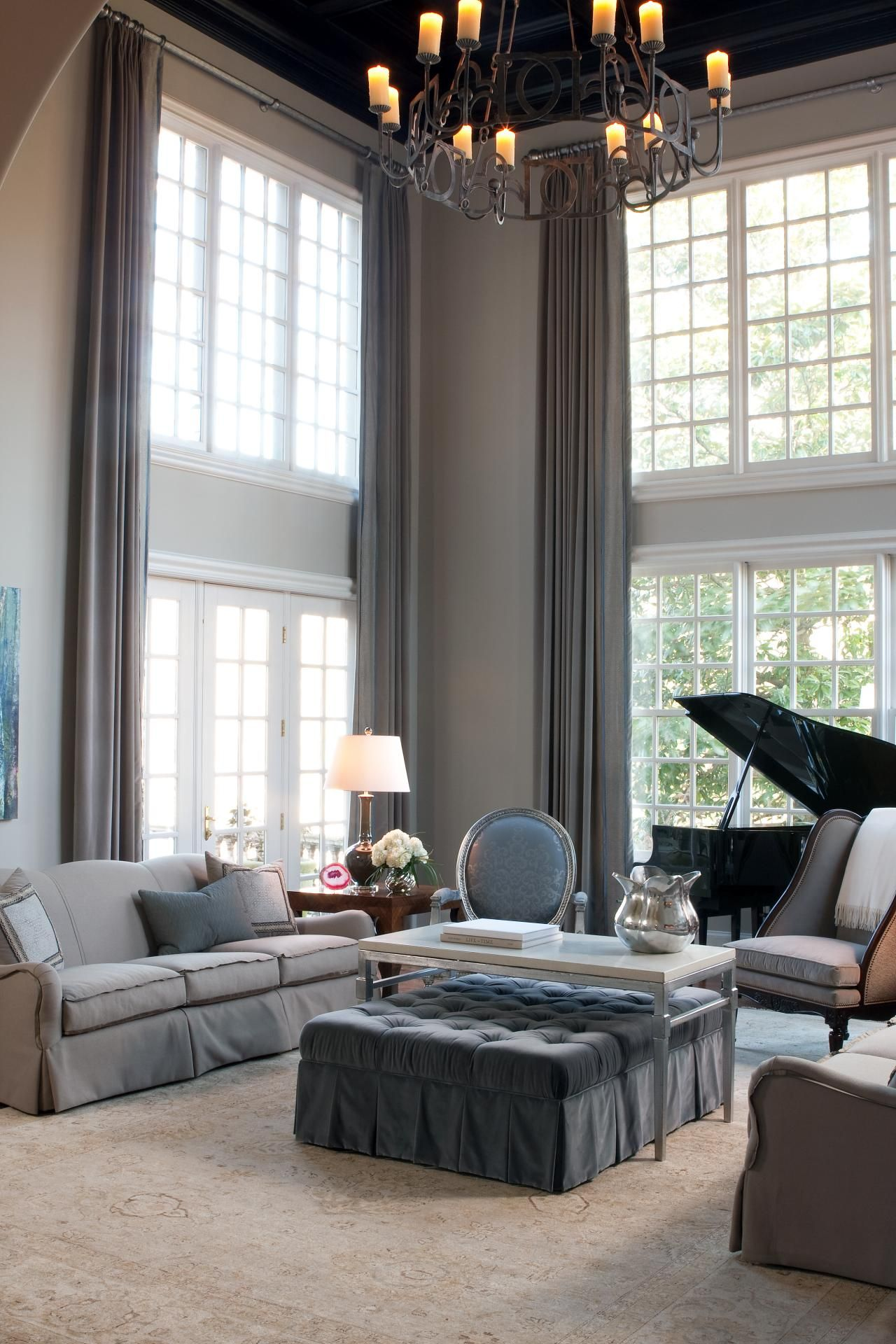 Formal Living Room With Two-Story Window Treatments | High ...