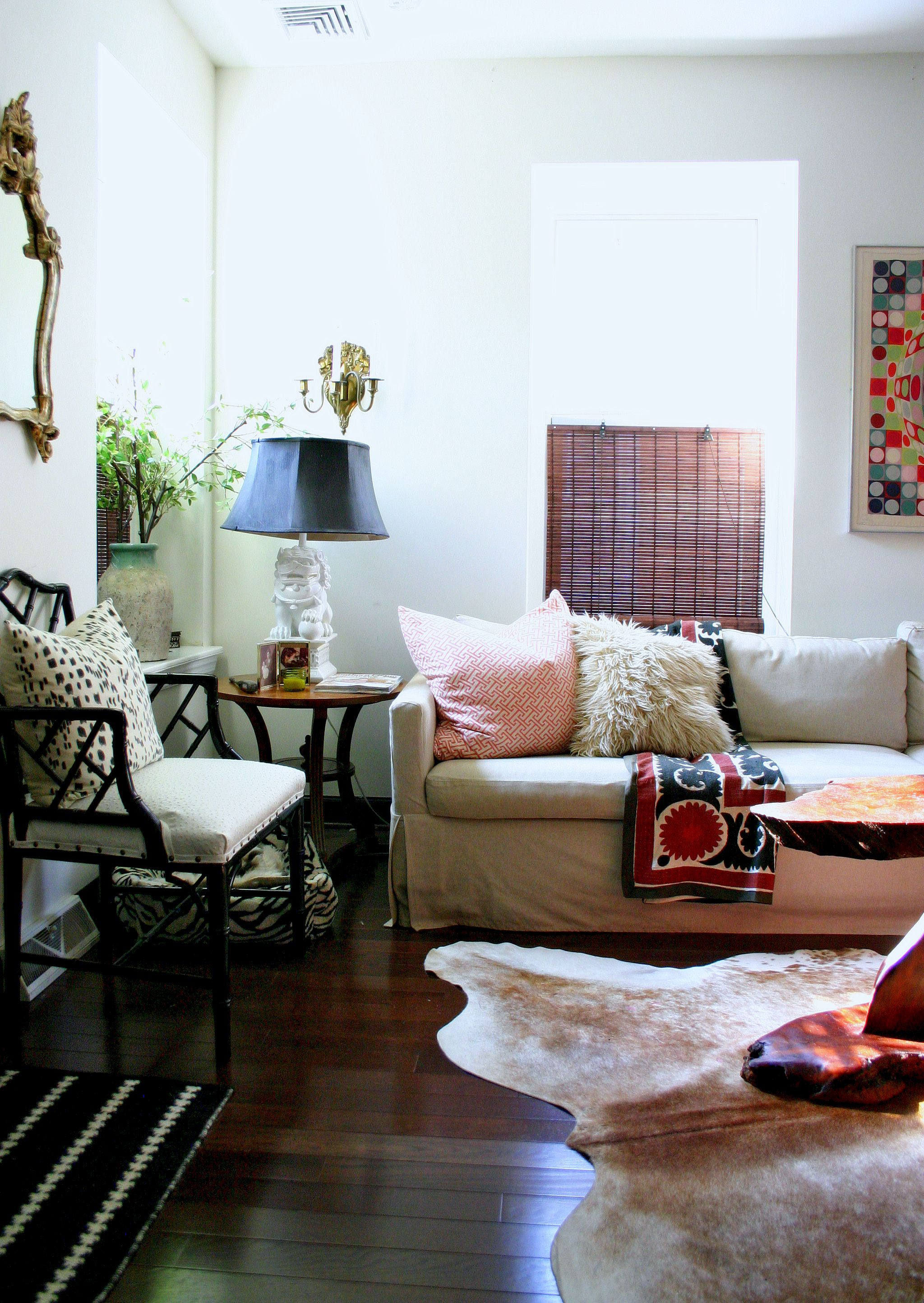 Cowhide rug slipcover sofa and bamboo chair