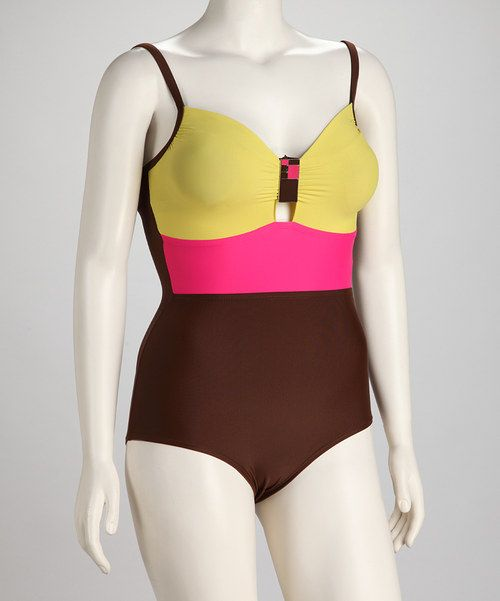 The classically feminine style of this one-piece swimsuit gets a trendy kick from a color blocking and a sassy jewel. Made to be completely body conscious, it boasts built-in support like tummy-thinning technology and a boosted bust to enhance A and B cups. Shell 1: 85% nylon / 15% spandexShell 2: 70% nylon / 30% spandex...