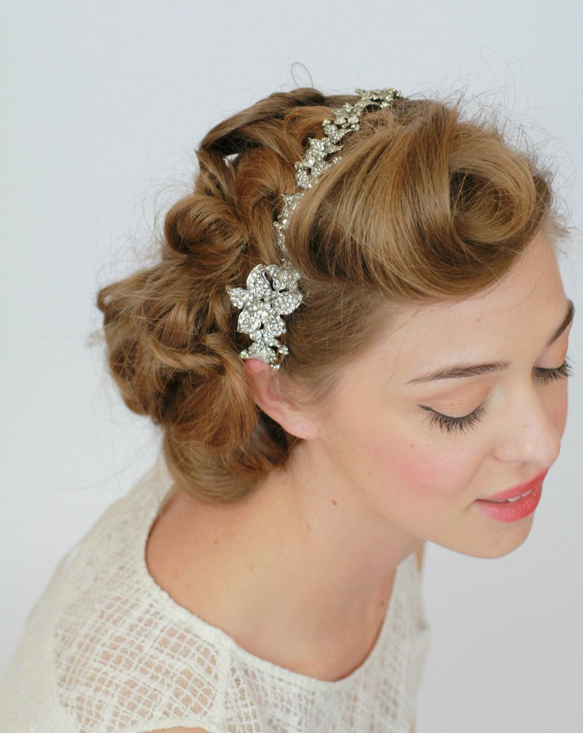 love this slightly 1940s (almost victory rolls) bridal updo