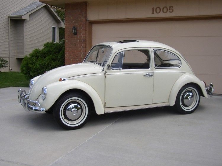 1966 Volkswagen Beetle with white walls. Hubcaps and