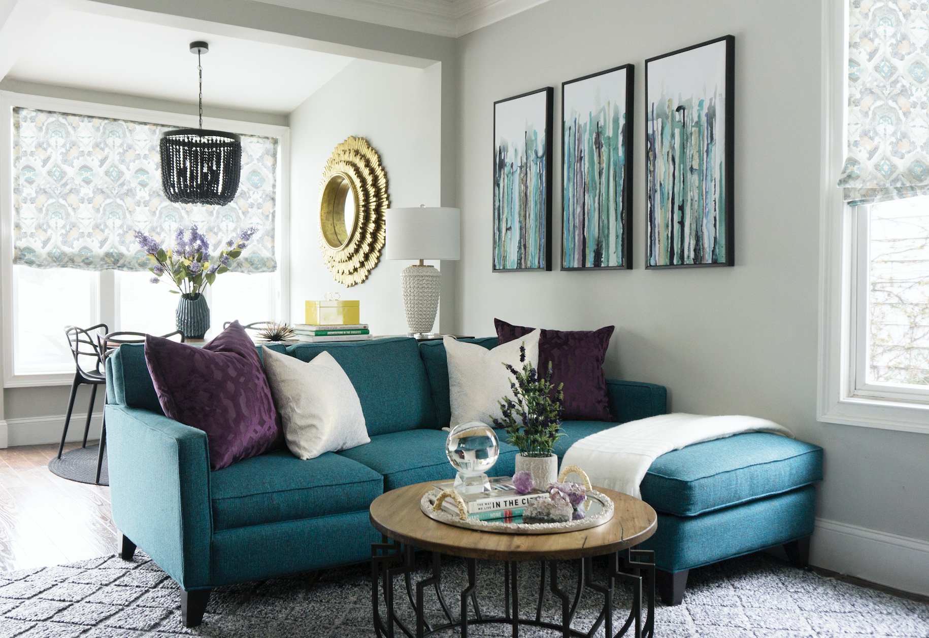 A Bright Open Concept Family Room With A Teal Sectional And Pops Of Accent Colors Living Room Designs Teal Living Rooms Family Room Decorating #teal #and #purple #living #room