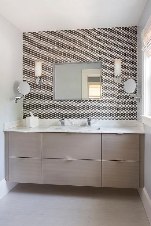 contemporary bathroom features a taupe veneer floating vanity