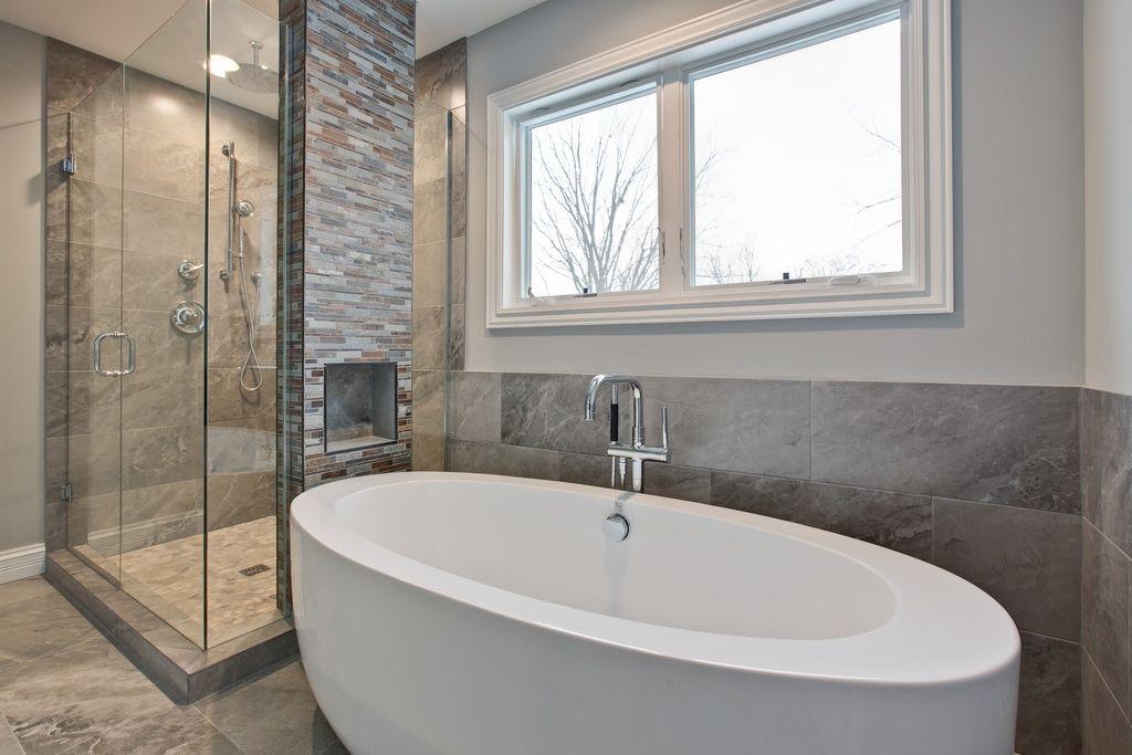 Contemporary Master Bathroom with Freestanding, limestone tile floors, Rain shower, High ceiling, Handheld showerhead