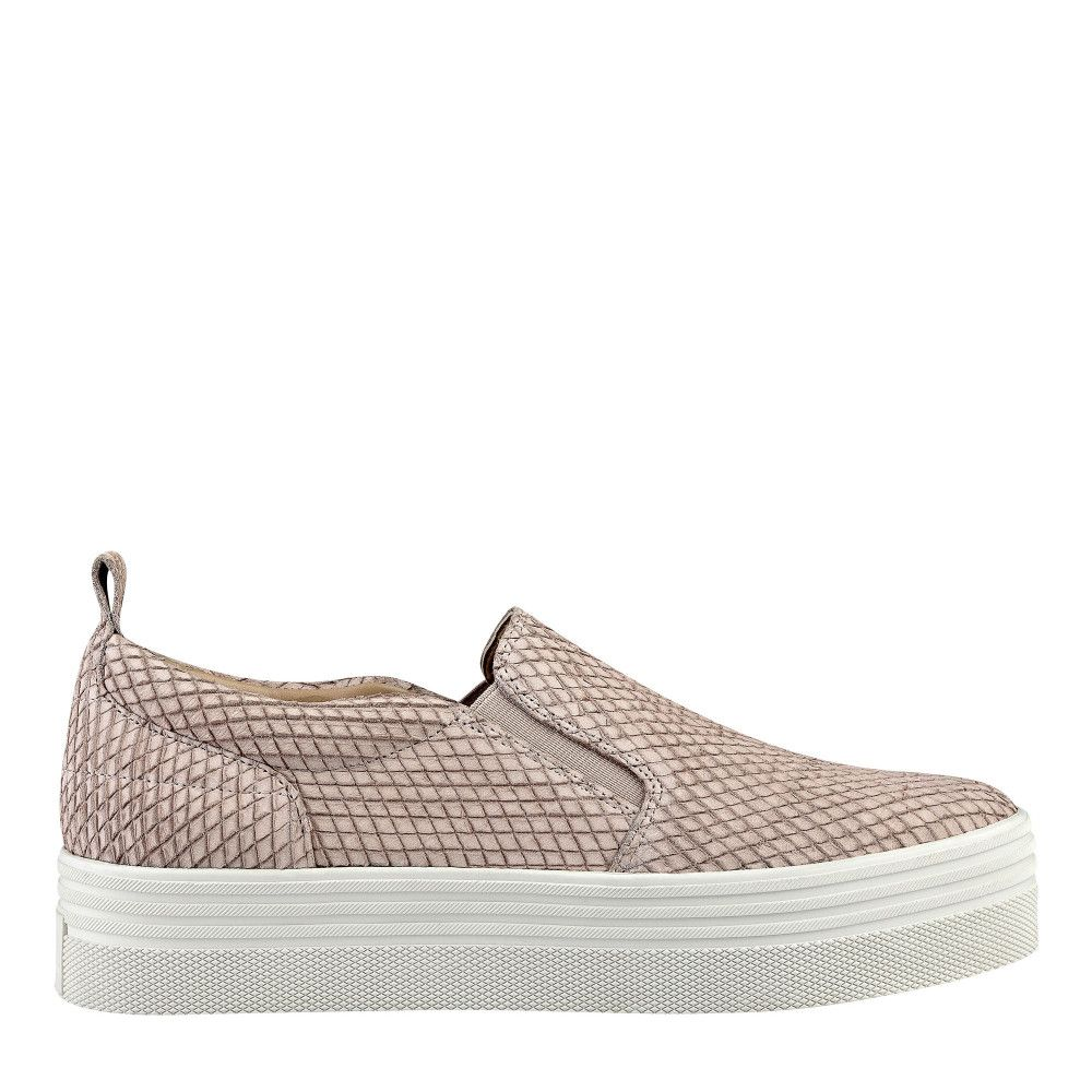 Easy slip-on sneaker with mixed media materials.