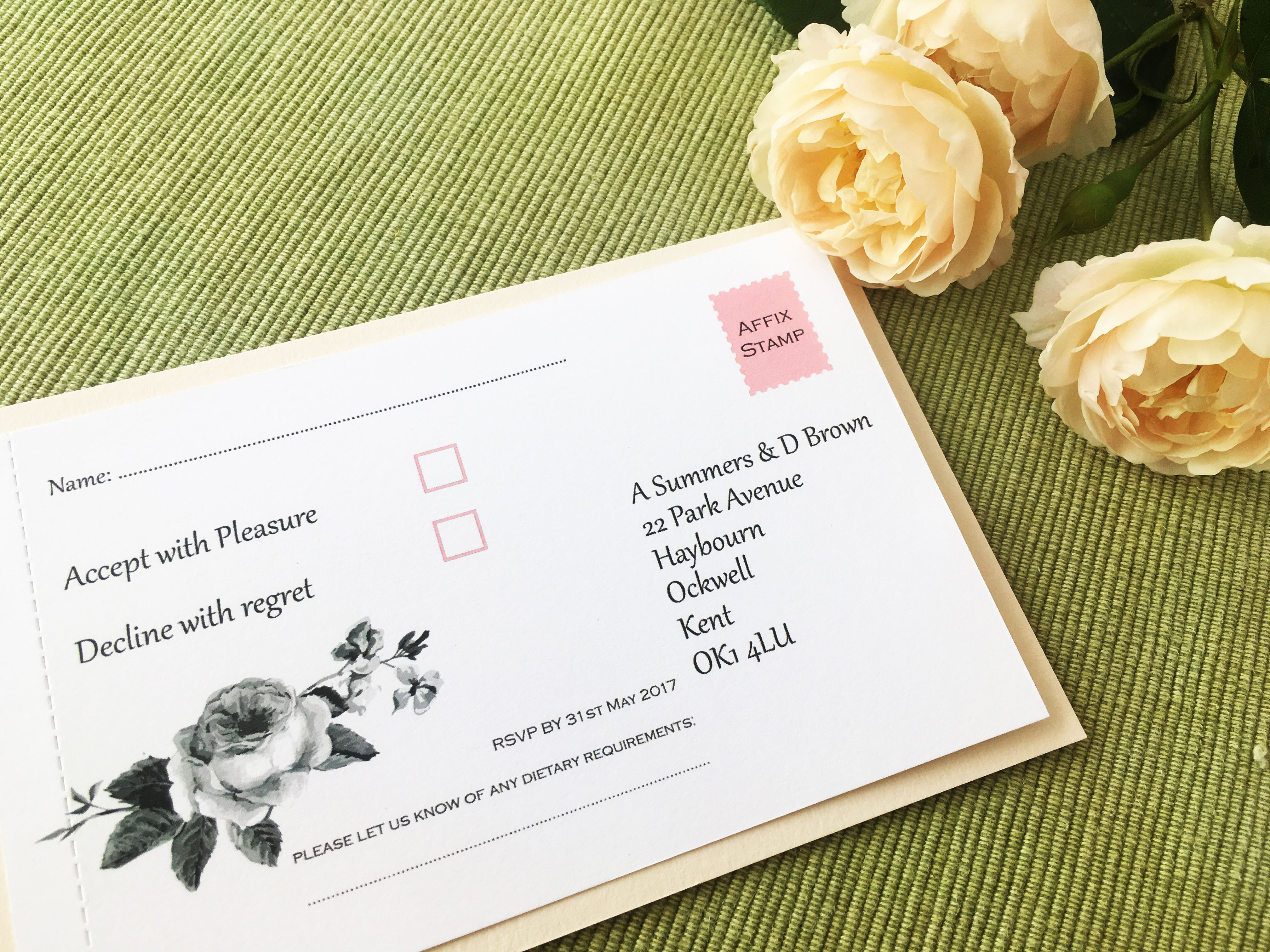 Botanical rose wedding invitation demonstrating the perforated reply ...