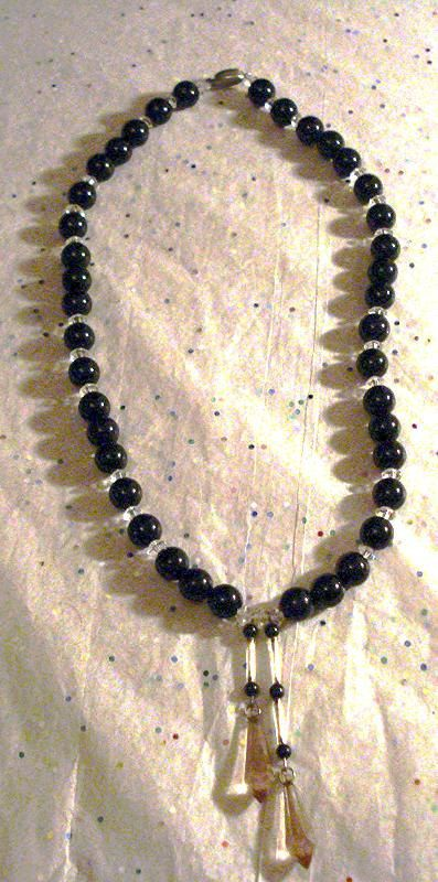 http://www.bonanza.com/listings/Vintage-Crystal-Sterling-Silver-Black-Glass-Beads-Mother-of-Pearl-and-Briolette/114917917