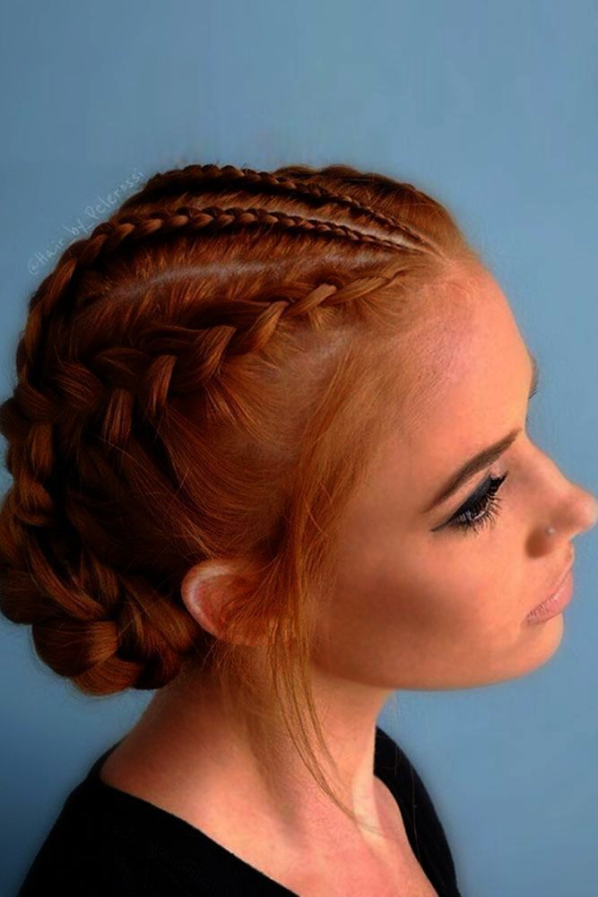 Hairstyle Crossword Clue