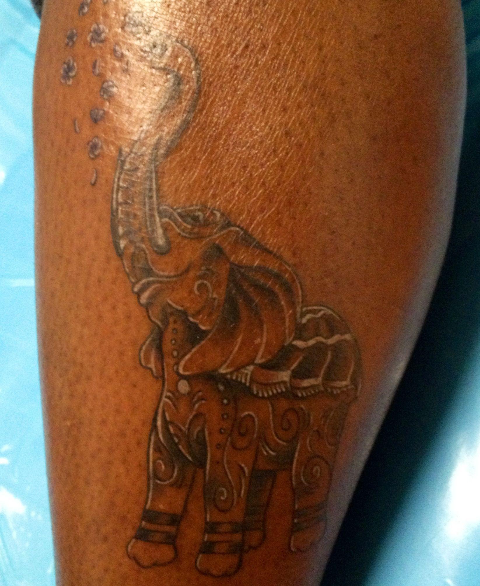 Elephant tattoo white ink and gray undertone Dark skin