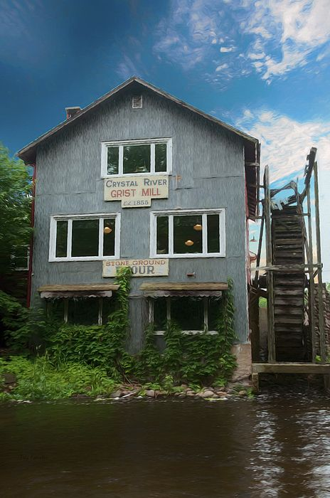 The Crystal River Grist Mill in Waupaca, Wisconsin, was established in 1855 and is now a tourist attraction with an outstanding gift shop and attractive acres which include a wedding chapel and a covered bridge across the river.