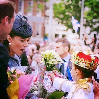 Lovely photo of Catherine receiving flowers.