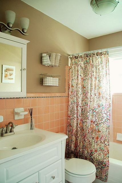 Wire baskets over toilet better than shelves in a small for Peach tile bathroom ideas