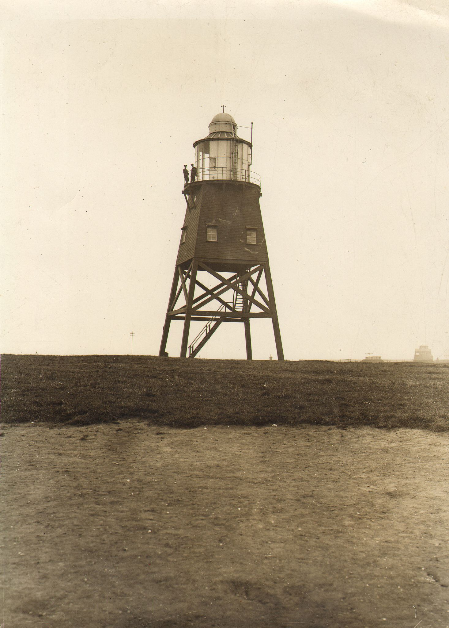 This is a photograph of a temporary lighthouse in Hartlepool.  Built in 1847 the wooden tower was in service until June 14th 1927.  On that day the new all electric, automatic Heugh light came into service.  Photograph Collection No : 1827  Images from Hartlepool Cultural Services that are part of The Commons on Flickr are labeled 'no known copyright restrictions' indicating that Hartlepool Cultural Services is unaware of any current copyright restrictions on these images either because the…