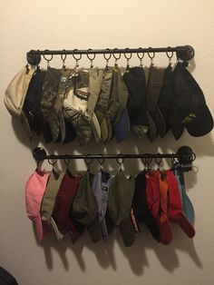 Ball Cap Storage With Towel Bars And Curtain Clips.