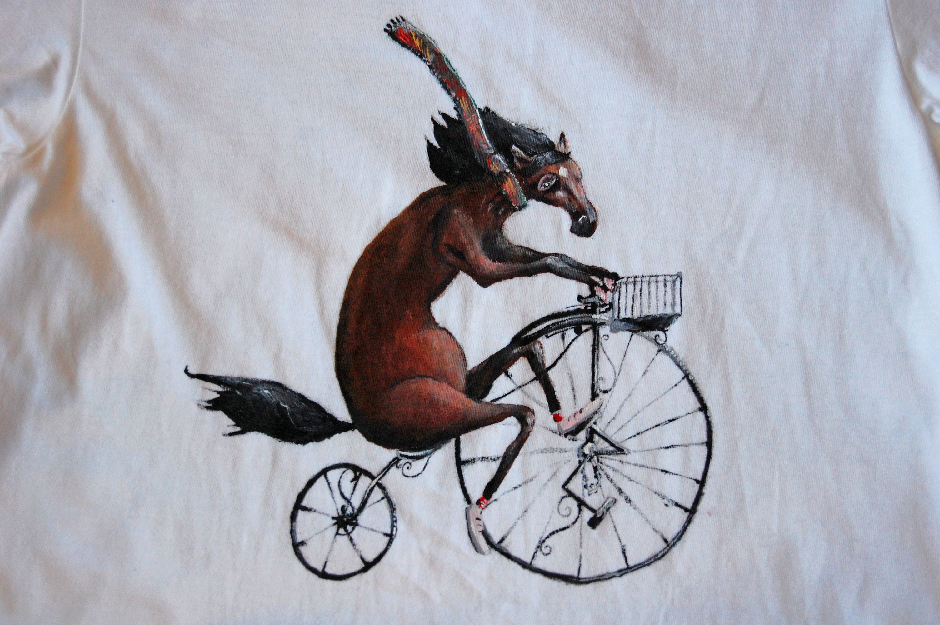 #handpainted #tshirts by @ipaintstuffontshirts. A horse who fancies himself as quite the thespian is cycling through Cambridge