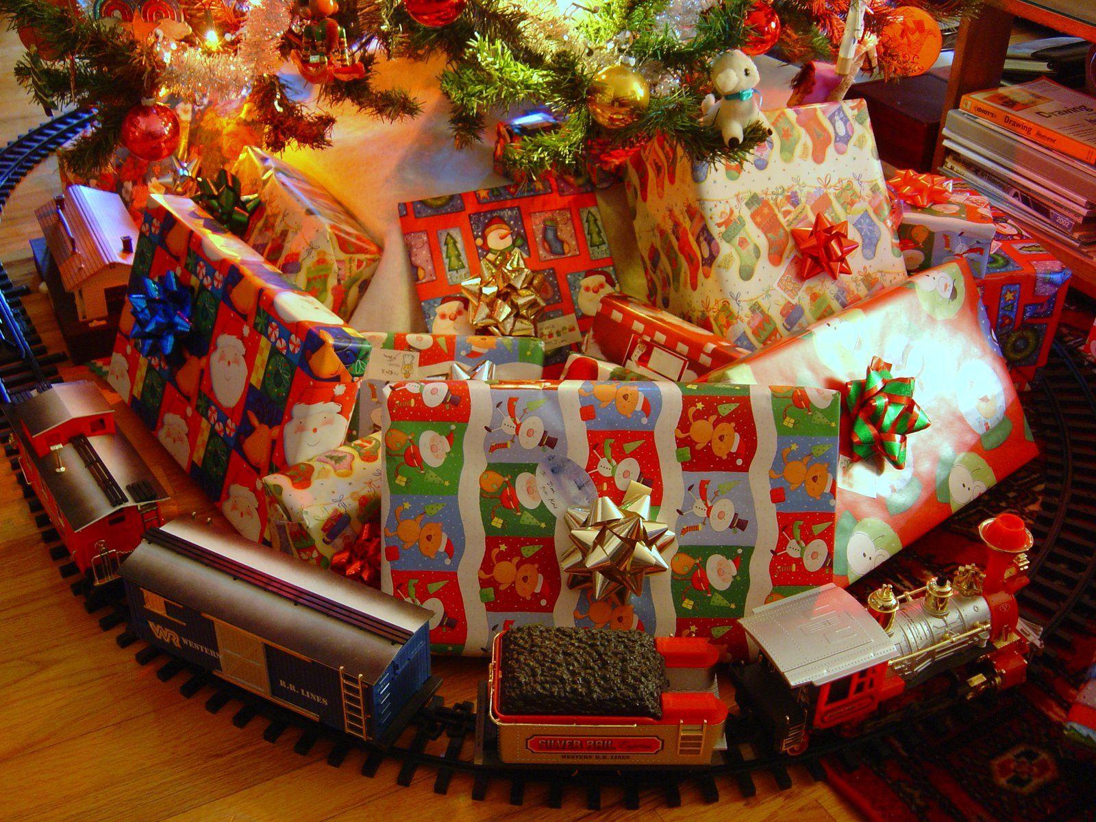 toy train running under a christmas tree :-) | Train under ...