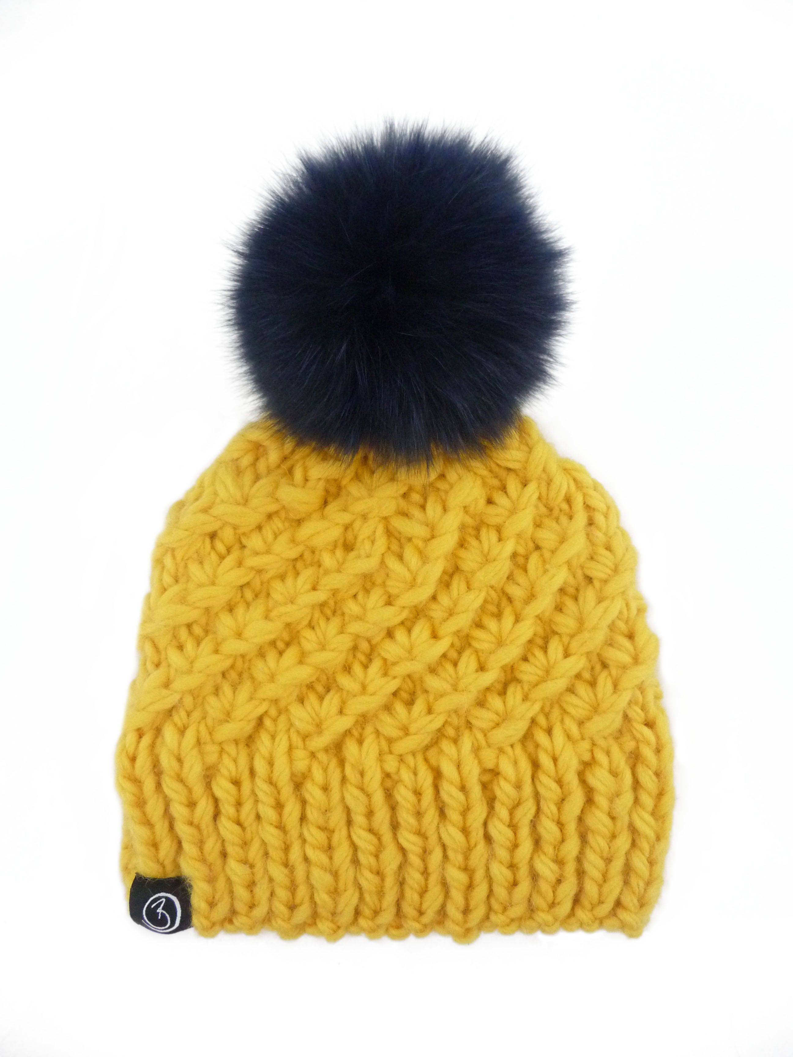 7b80c896cab Mustard chunky hand knit hat with a navy blue fox fur pom pom Bobble Hats