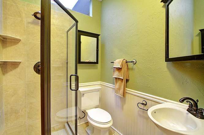 glass shower, pedestal sink and beadboarding make this simple 3/4