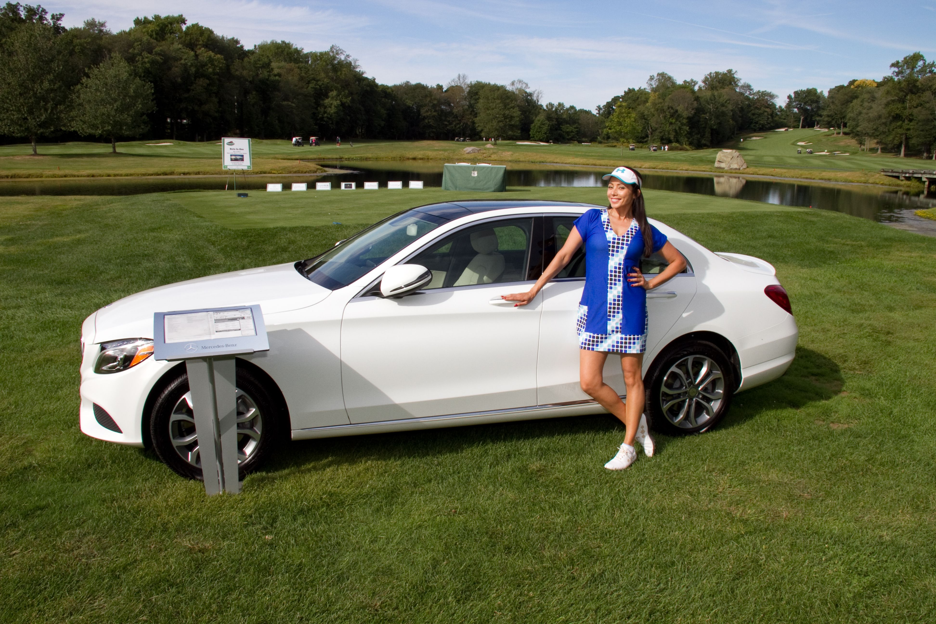 Rachel Grant at a recent Golf Outing in the Stacy II Cobalt Cubes Dress #GOLFDRESS #Golffashion #ladiesgolfdress #Bluegolfdress #Golfapparel #golfing #ladiesgolf #9ndine #9anddine #9andine #9&dine #rachelgrant