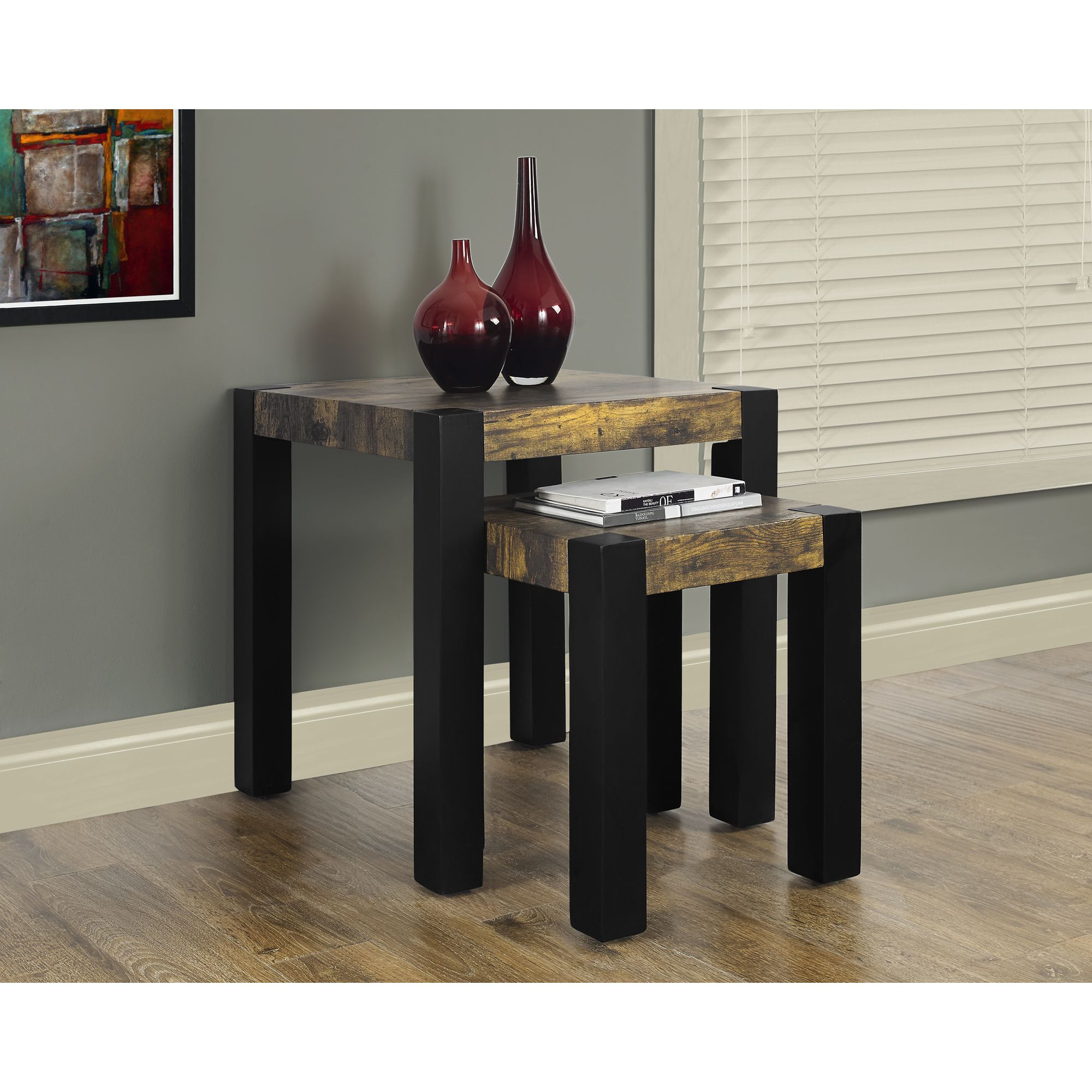 Introduce a rustic feel in any space with this set of two nesting tables. Made to have a distressed and reclaimed wood-look this set of tables adds warmth to your home.