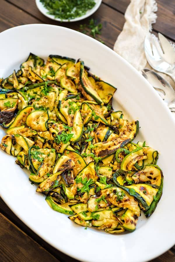 This Ultimate Zucchini Salad is so flavorful and healthy, you'll want to make it all summer long! Seasoned with lemon-parsley dressing, it requires only 5 ingredients! #zucchini #vegan #healthy #salad