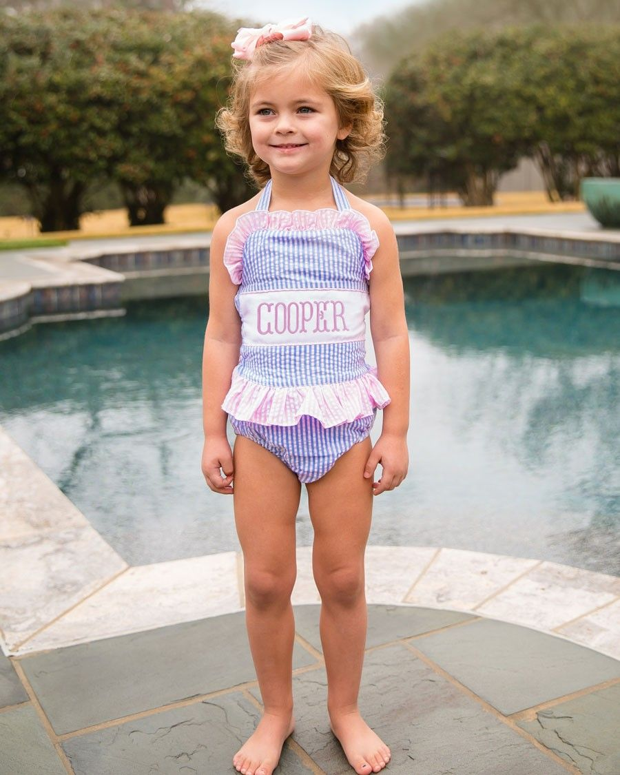 3c27695374 She'll be the talk of the pool party in this personalized swim suit! Blue seersucker  swim suit ties around the back, and has a waist ruffle.