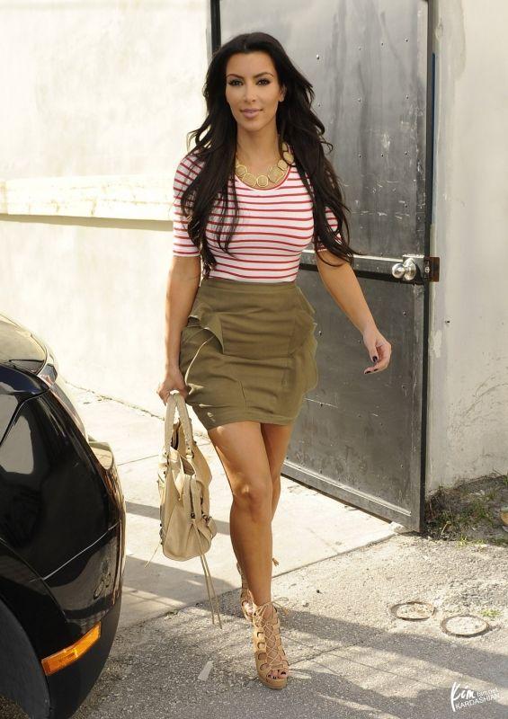 Kim Kardashian wearing Christian Louboutin Miss Fortune Platform Sandals in  Tan Balenciaga City Bag in Sahara HM Stripe Tee In Red. 38b77ca82a357