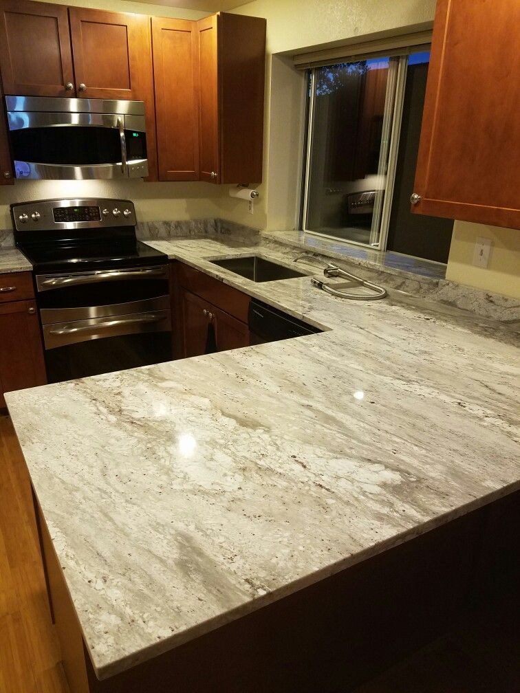 White Glacier Granite Counter Tops With Maple Cognac Cabinets