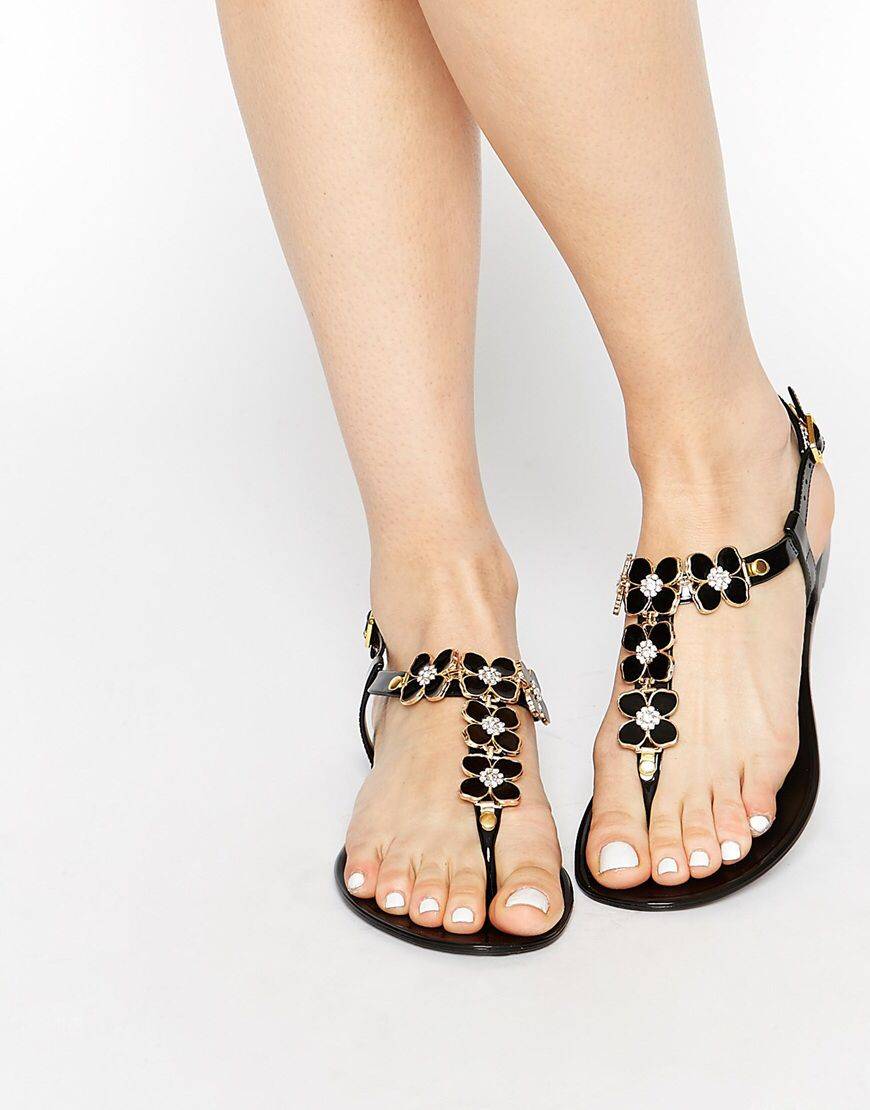 a64d6c01ed8 Shop Truffle Collection Flower Toe Post Flat Sandals at ASOS.