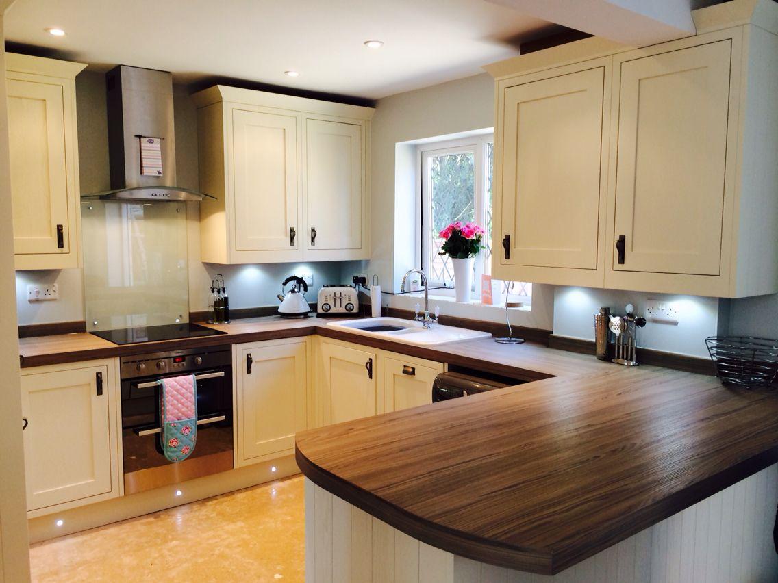 Cream country kitchen with cypress cinnamon worktops