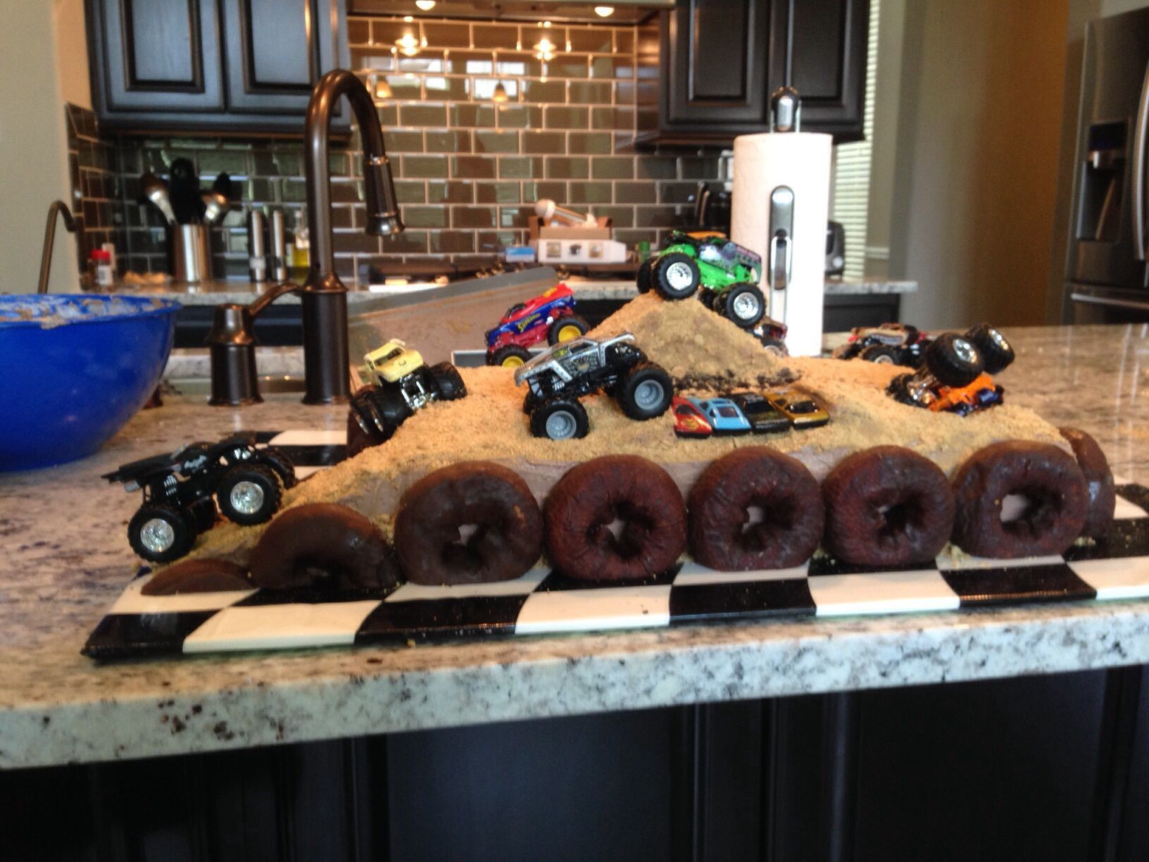Great, Creative Boyu0027s Birthday Cake . Monster Truck, Matchbox Truck Course  With Donut Tire Border And A Rice Krispie Jump.