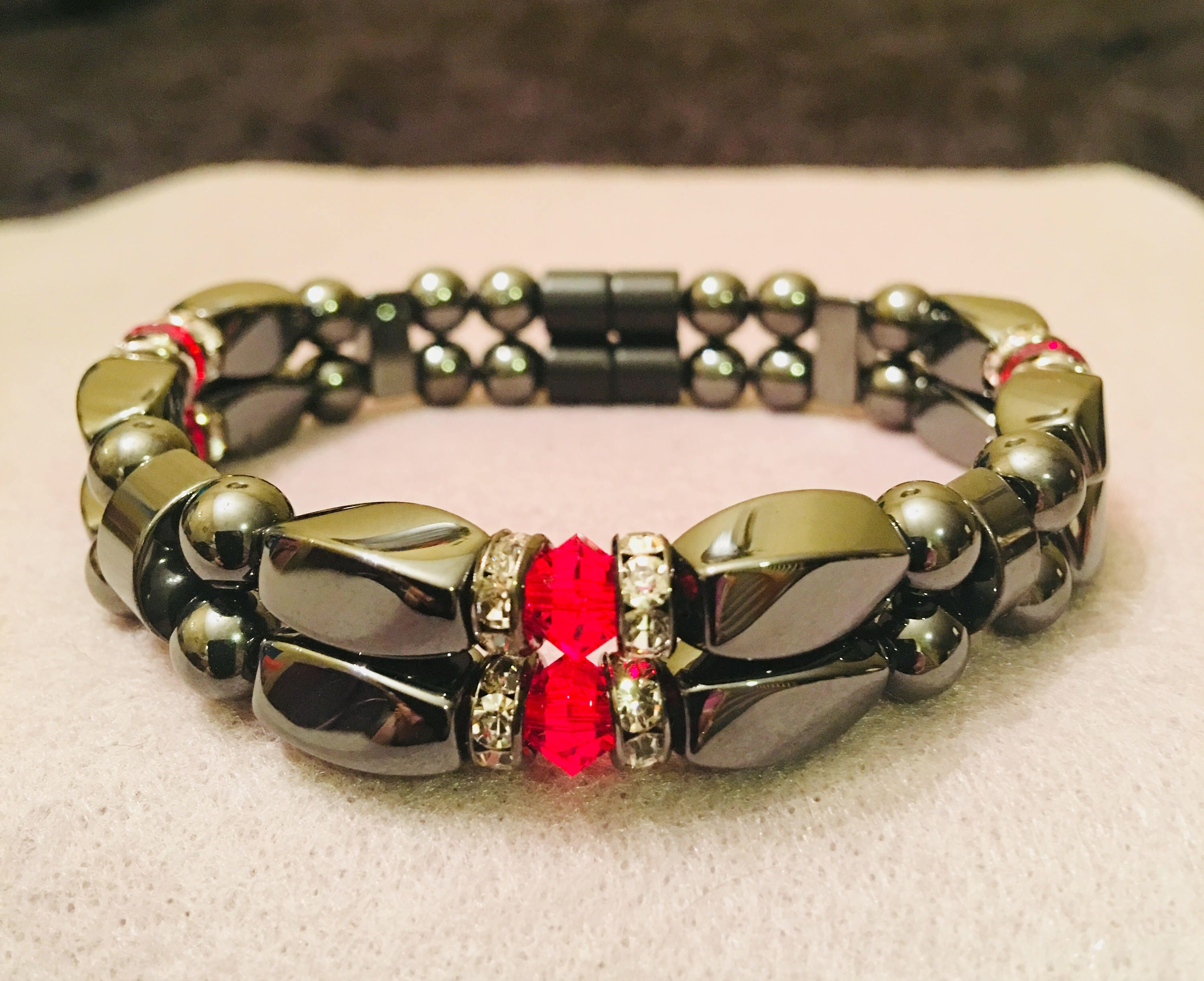 e0bc24034 Here is January Birthstone Garnet Red Swarovski High Power Magnetic  Hematite Bracelet. FREE SHIPPING until January 31st on this item!