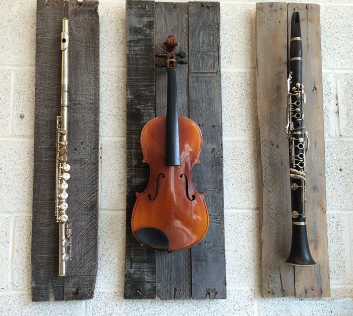 This trio of mounted recycled instruments would be the perfect wall art for any music lover.