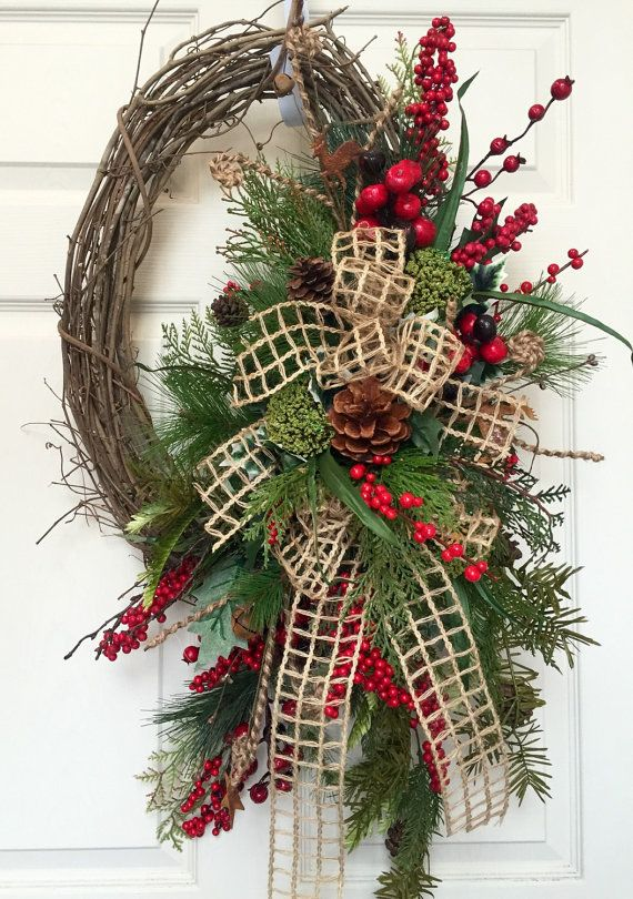 She hung it on a smaller size outside door with a wreath hook and it looks great!.