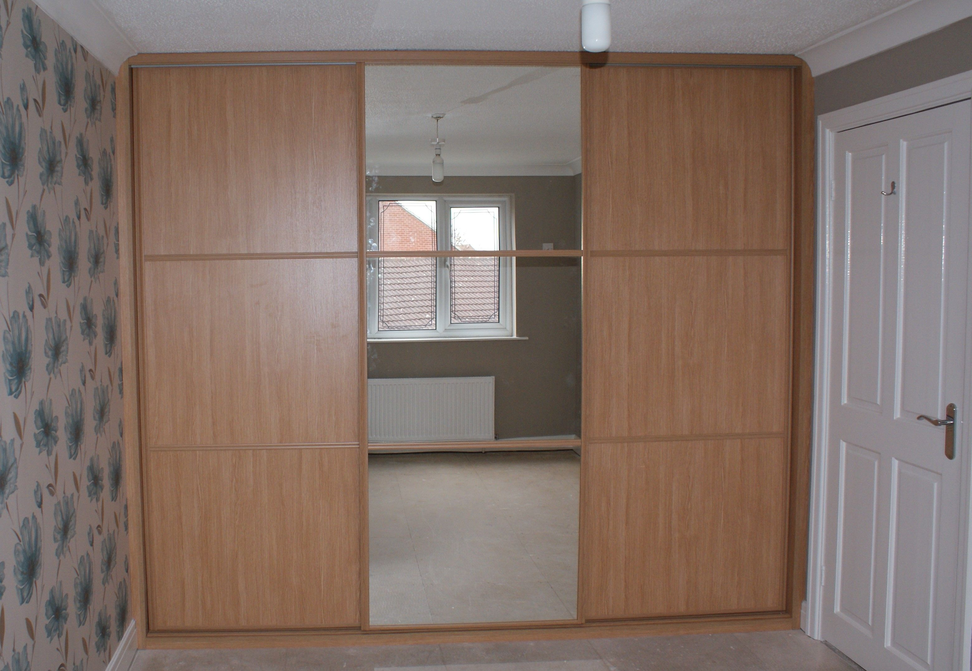 A Custom Fitted Moonlight Bedroom With Sliding Doors Made To
