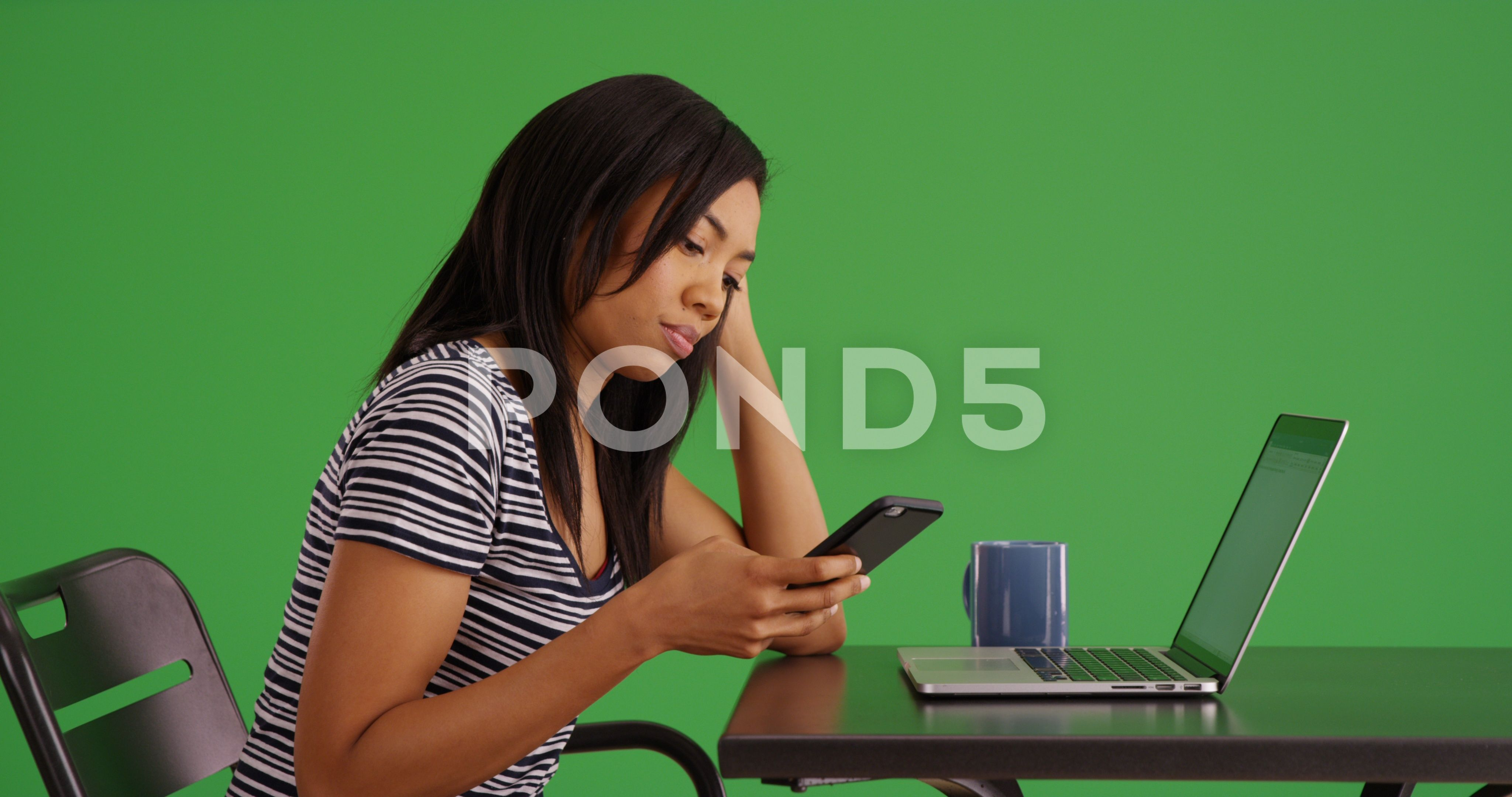 Black Woman Texting On Phone While Working On Laptop At Cafe On Green Screen Stock Footage Phone Working Texting Black Greenscreen Black Women Women