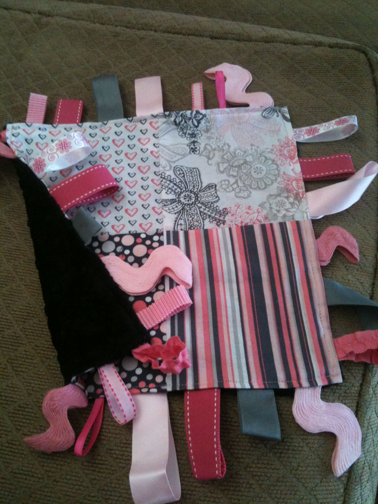 First attempt at a tag blanket for my little princess!! It matches all her homemade bedding as well!